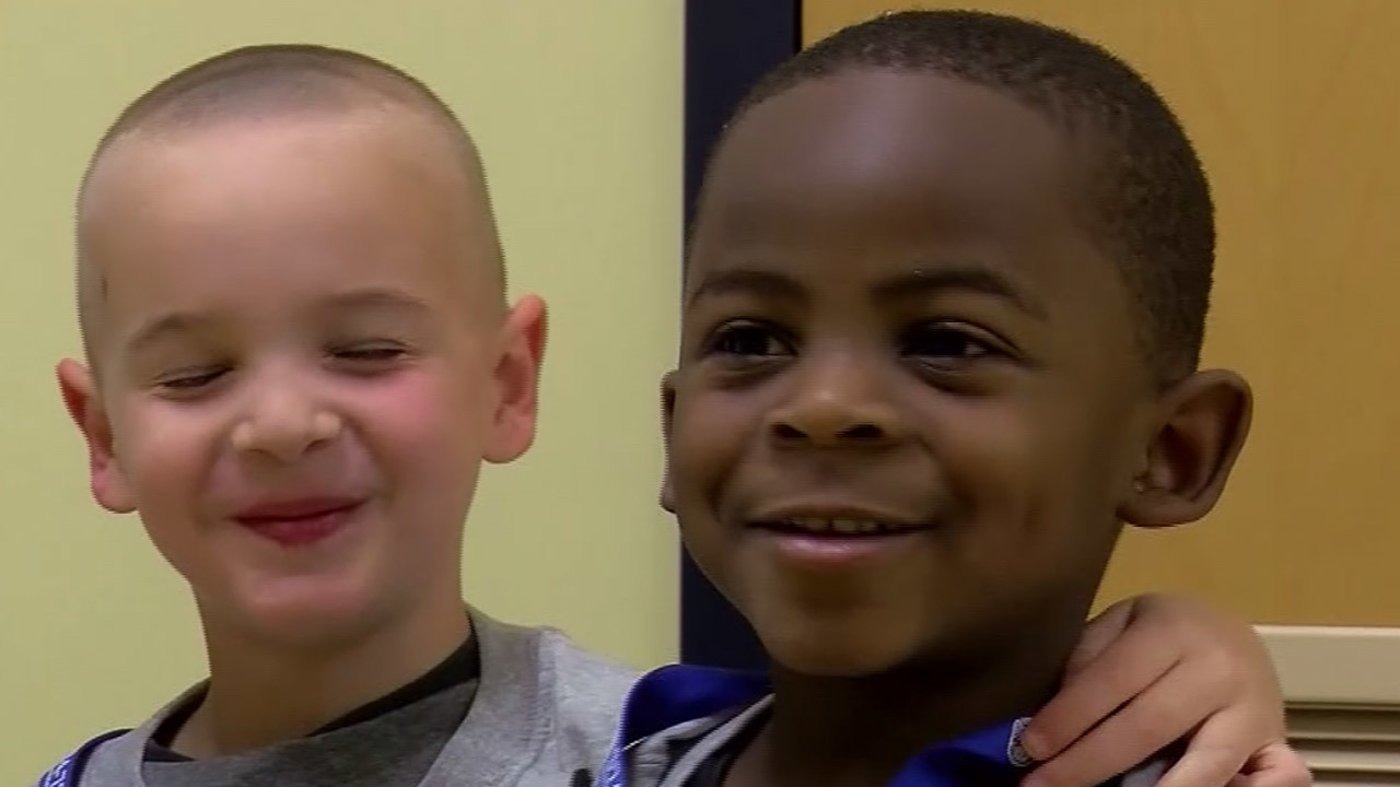 Viral Haircut Twins Honored By Police Officer