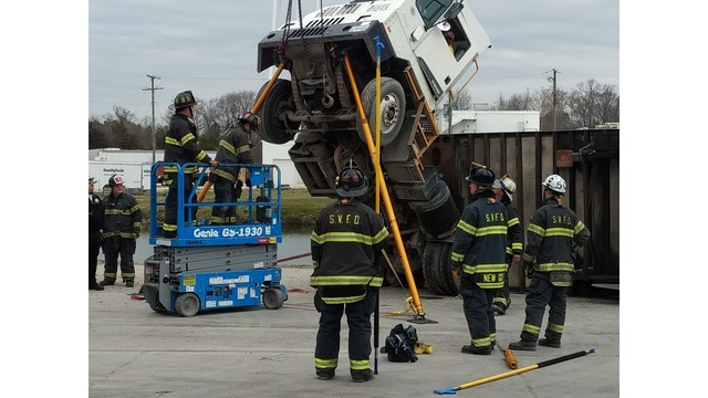 Tractor-trailer overturns at Smithfield Foods, firefighters rescue driver