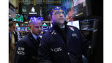Stocks end worst year in a decade, dreadful December with slight gains