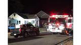 Fire departments battle house fire