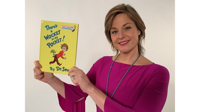 Kerri Furey with Dr Seuss book.JPG