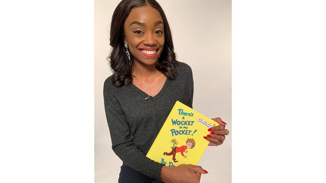 Kiahnna Patterson with Dr Seuss book.JPG