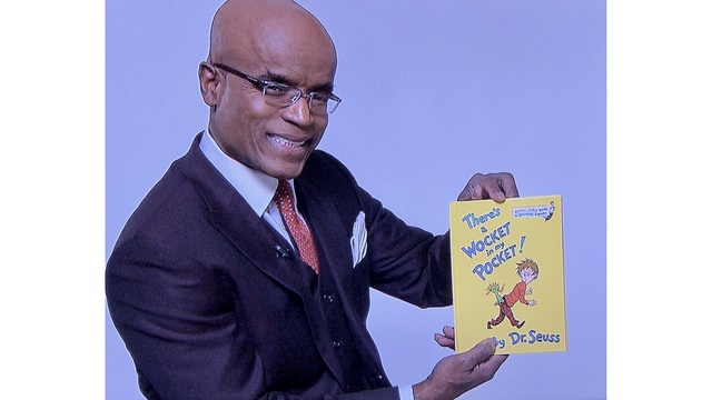 Don Roberts with Dr Seuss book.JPG