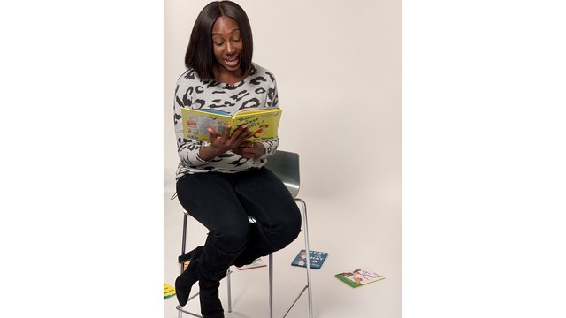 Symone looks down reading Dr Seuss.JPG
