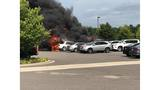Photos: Vehicles catch on fire in Norfolk airport parking lot
